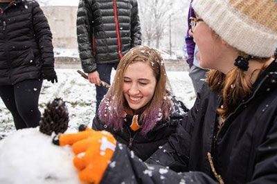 students build a snow man
